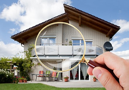 A house under a magnifying glass
